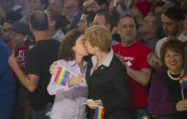 Married couple Pam Grey, left, and Zoe Dunning kiss to celebrate the U.S. Supreme Court's ruling on Proposition 8 at San Francisco's City Hall on Wednesday.