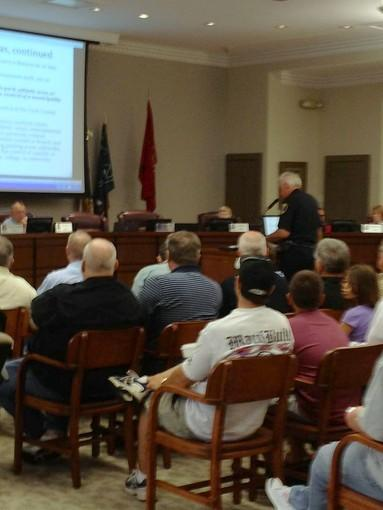 A packed house listens as Police Chief Jim Lamkin explains the new concealed carry legislation to St. Charles aldermen.