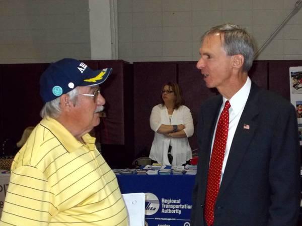 U.S. Rep. Dan Lipinski, right, talks with a senior citizen at a senior fair in Romeoville.