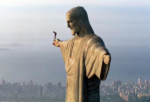 "Austrian parachuter Felix Baumgartner, who goes by the code name ""Base 502,"" prepares to jump from the arm of the Christ the Redeemer statue atop Corcovado mountain, overlooking Rio de Janeiro on Dec. 1, 1999."