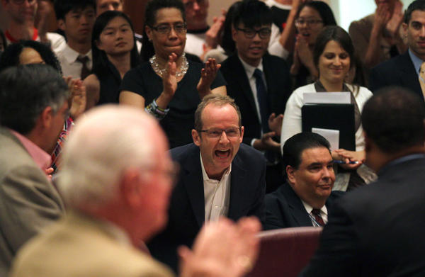 Ald. Tom Tunney, 44th, middle, who is gay, makes an impassioned speech that included his pride and happiness in the defeat of the Defense of Marriage Act and is given a standing ovation from the city council and observers.