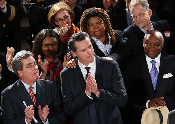California Lt. Gov. Gavin Newsom looks on during a rally after hearing results from the U.S. Supreme Court's rulings on gay marriage at San Francisco City Hall.