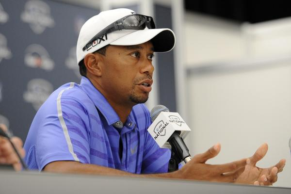 Tiger Woods told reporters Wednesday he plans to play in the British Open whether his left elbow is 100% or not.