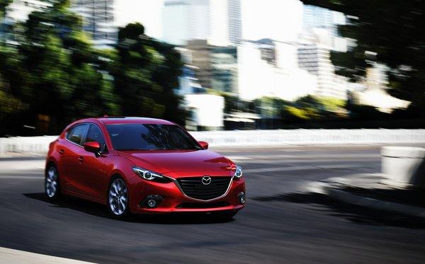 Mazda unveiled the all-new 2014 Mazda3 hatchback and sedan. The car will go on sale in the fall.