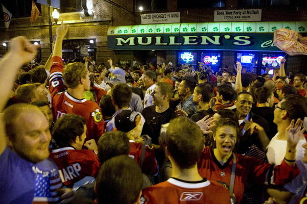 Fans celebrate the Blackhawks' Stanley Cup championship early Tuesday in Wrigleyville.