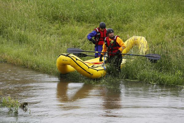 "Divers head into the Flint Creek in Lake Barrington on Wednesday. Dozens of divers from Barrington and the surrounding area were focusing their efforts in this area in what has been described as ""swift water rescue."""