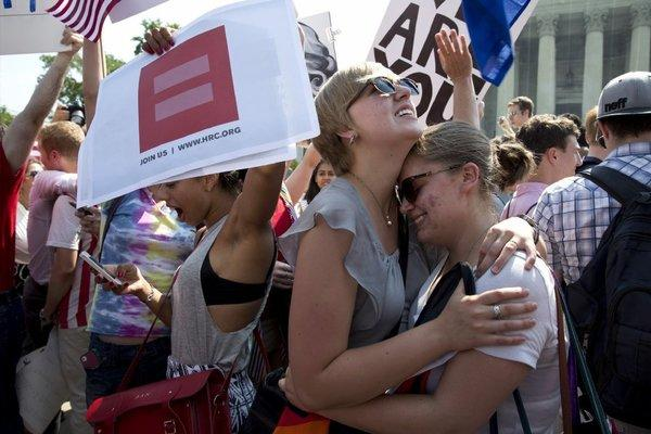 Demonstrators celebrate outside the U.S. Supreme Court on Wednesday after the court ruled in cases involving the Defense of Marriage Act and California's Proposition 8.