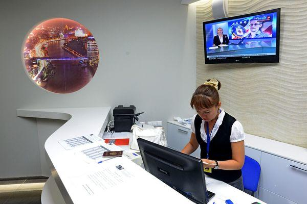 An employee works at the reception desk at the Capsule Hotel Air Express at Moscow's Sheremetyevo airport, where Edward Snowden is said to have landed Sunday.