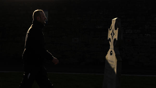 A man walks past a memorial to those who worked in the Magdalene Laundries, at Glasnevin Cemetery in Dublin.