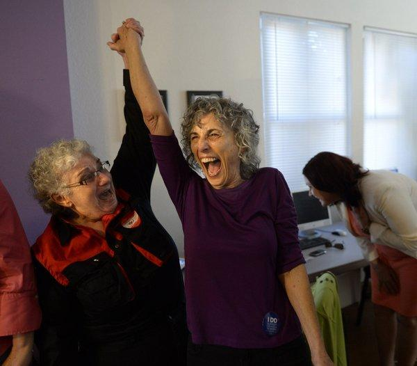 Shelly Bailes, left, and her wife, Ellen Pontac, celebrate in Sacramento after hearing that the Supreme Court struck down the Defense of Marriage Act.