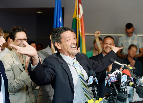 West Hollywood Councilman John Duran celebrates during a news conference at City Hall after the U.S. Supreme Court actions on gay-marriage cases.