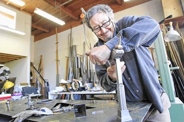 Artist Jon Seeman, 62, works on a steel sculpture at his studio in Laguna Beach on Tuesday. Seeman will showcase his latest work during Laguna Beach's 2013 Festival of the Arts.