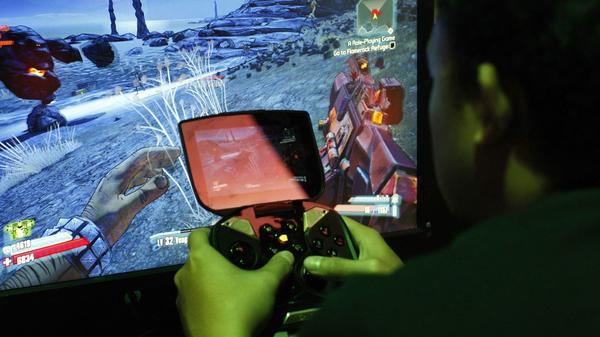 A man tries a game at the Nvidia Shield at E3, the Electronic Entertainment Expo this month in Los Angeles.