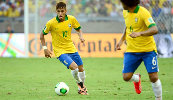 Brazilian forward Neymar drives the ball during Brazil's 2-1 victory over Uruguay in their Confederations Cup semifinal.