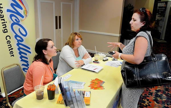 Jessica McCollum, left, and Tara Bockstanz of McCollum Hearing Center talk with Gaby Polanco at the 2013 Hagerstown-Washington County Chamber of Commerce Business Expo at the Hager Hall Conference and Event Center Wednesday. Polanco is with Lutheran Home Care & Hospices, Inc.