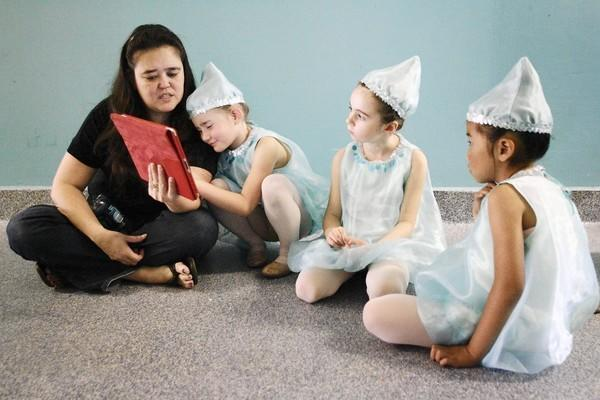 "Michele Ferren, from left, reads ""Junie B. Jones and Some Sneaky Pesky Spying"" to her daughter, Madison, 6, Isla Welsh, 6, and Sydney Chan, 6, during rehearsal for an upcoming performance, ""Thumbelina,"" which took place at the California Contemporary Ballet dance studio in La Canada on Saturday, June 22, 2013."