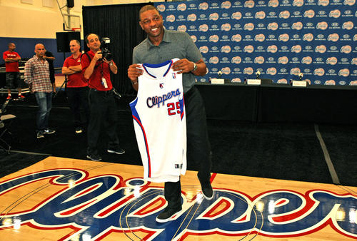 """Former Boston Celtics coach Glenn """"Doc"""" Rivers holds a Clippers jersey with his number and name on it while meeting members of the press introducing him as the new coach of the Los Angeles Clippers at the Clippers Training facility in Playa Vista."""