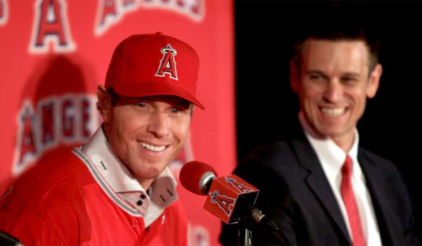 Angels General Manager Jerry Dipoto, right, says he thinks Josh Hamilton, left, who is hitting .214 with 10 home runs and 26 runs batted in, will overcome his struggles at the plate.