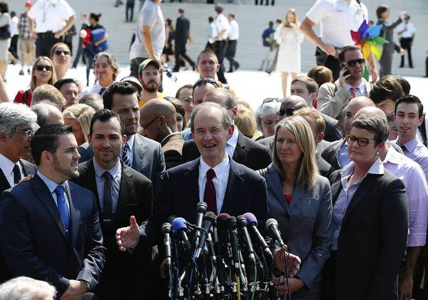 Attorney David Boise (center) speaks Wednesday in front of the Supreme Court building while flanked by plantiff couples Paul Katami (left), Jeff Zarillo (second left), Sandy Steier (second right) and Kris Perry (right) after the court ruled that part of the Defense of Marriage Act is unconstitutional.