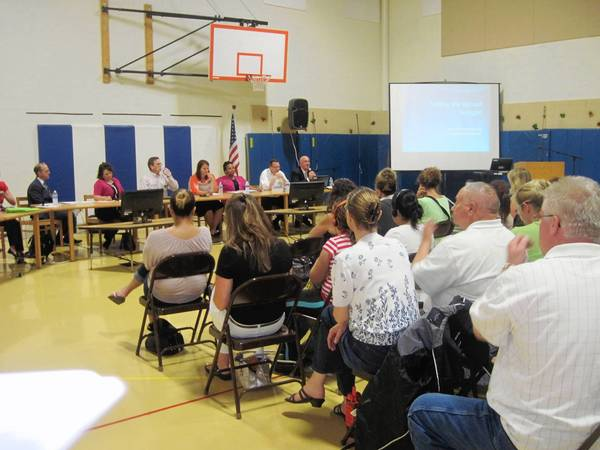 Parents attend a meeting about bilingual education at Conrad Fischer School in Elmhurst.