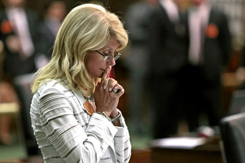 Texas state Sen. Wendy Davis (D-Fort Worth) was still standing after her 13-hour filibuster and the blocking of a vote on Republicans' antiabortion bill before midnight Tuesday.