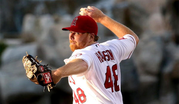 Tommy Hanson was scratched from a start for the Angels against the Detroit Tigers because of tightness in his right forearm.