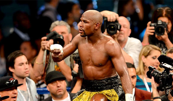 The Sept. 14 fight between Floyd Mayweather Jr., above, and Saul 'Canelo' Alvarez has sold out, generating a live gate of more than $19 million in less than 24 hours.