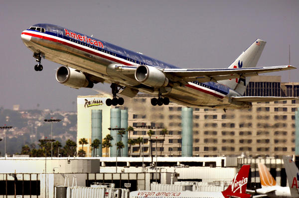 In September the FAA is expected to announce that it will ease restrictions on the use of mobile devices during takeoffs and landings. Cellphone calls and Internet transmissions will probably remain off-limits. Above: An American Airlines jet departs from LAX in Los Angeles.