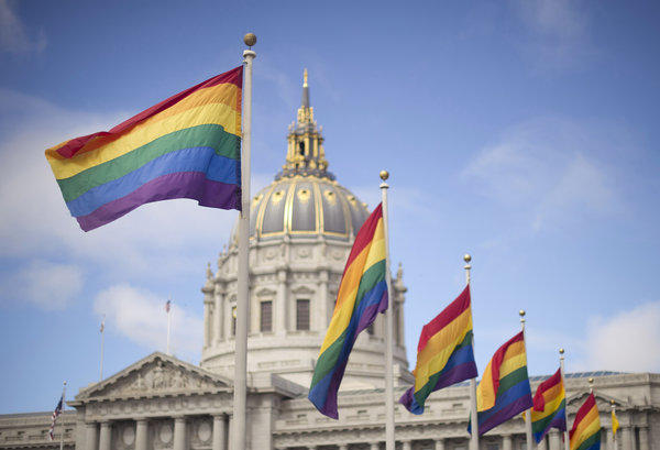 The U.S. Supreme Court ruled that Proposition 8's proponents lacked legal standing to appeal a lower court decision declaring that measure unconstitutional, which is hardly a decisive national ruling in favor of marriage equality. Above: Rainbow flags fly in front of San Francisco City Hall shortly after the U.S. Supreme Court decision that cleared the way for same-sex marriage in the state.