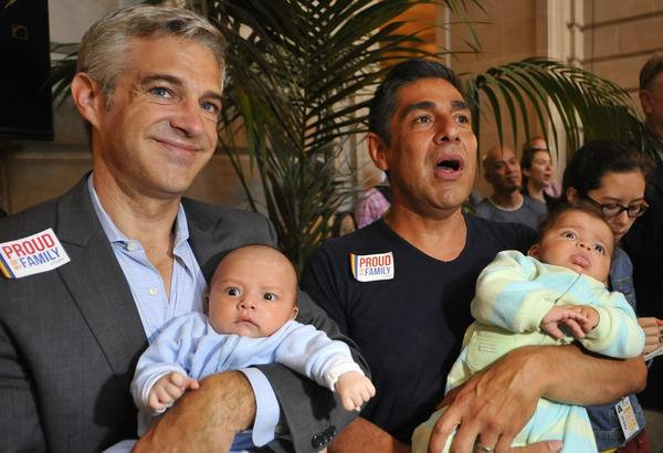 Chris Roe, left, and Roby Chavez celebrate the Supreme Court's decision to strike down the Defense of Marriage Act while holding their soon-to-be adopted children in San Francisco.