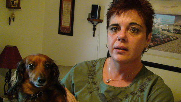 "Jane Rainboth, 46, of Deerfield Beach, was warned by her dog, Darla, that an intruder was in her home. Rainboth reached for the nightstand and shouted, ""I got a gun! I got a gun!"" It scared off the intruder."