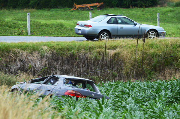 After rolling several times down an embankment, this Honda came to rest in a cornfield along Grove Road and Ringgold Pike on Wednesday morning. A 17-year-old male was taken to Meritus Medical Center after the crash.