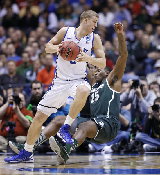 Duke's Mason Plumlee drives through Michigan State's Derrick Nix in second half action.