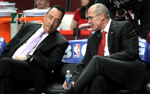 Bulls general manager Gar Forman speaks with vice-president of basketball operations John Paxson before the start of game.