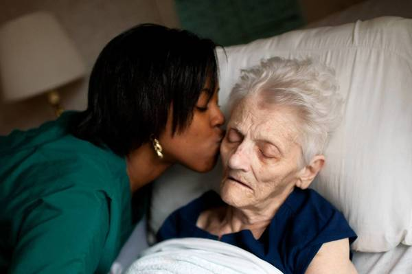 Certified nursing assistant Deonna Wallace spends time this month with Margaret Kinloch, 87, at ManorCare Health Services in Oak Lawn.
