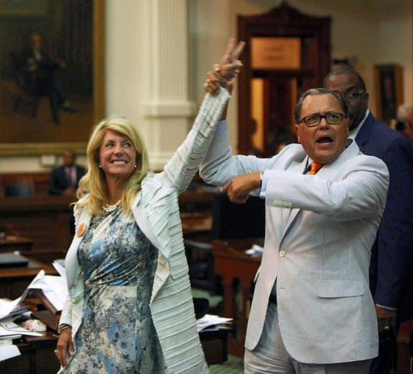 State Sen. Jose Rodriguez (D-El Paso) celebrates with state Sen. Wendy Davis (D-Ft. Worth) after her 13-hour filibuster ran out the clock on a vote on an antiabortion bill. Gov. Rick Perry said Wednesday that he will convene another session of the Texas Legislature on Monday at which the bill will be heard.