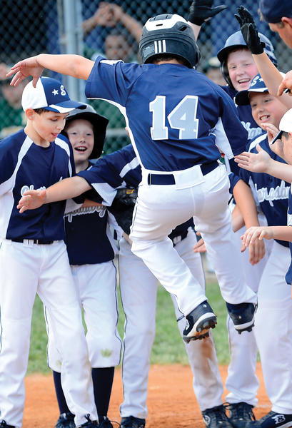 With his teammates waiting for him, Sharpsburg's Matt Kulikowski jumps onto home plate after hitting a two-run home run in the second inning against West End in Wednesday night's Maryland District 1 9-10 Tournament winners' bracket final at Sharpsburg Little League.