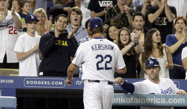 Clayton Kershaw walks off the field to a standing ovation after giving the Dodgers eight innings of work, giving up four hits, two earned runs while striking out seven Giants in L.A.'s 4-2 victory over San Francisco.
