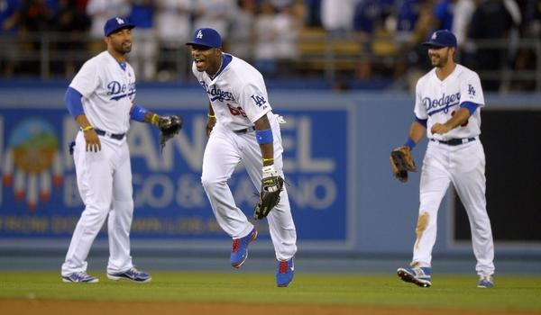 Rookie outfielder Yasiel Puig, center, is hitting .435 with seven home runs and 14 runs batted in for the Dodgers.