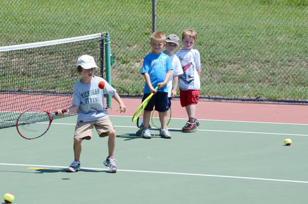 Jack Campbell eyes a ball during a Petoskey Parks and Recreation tennis session Wednesday at the Petoskey High School tennis courts. Campbell along with (from left) Jack Rasmussen, Taylor Keiswetter and Marshall Corey all took part in the age 5-6 mighty mites group as directed by Dree Lo.