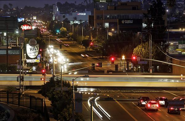 A Metro Expo Line train crosses Crenshaw Boulevard at Exposition Boulevard in the Crenshaw District of Los Angeles. A new light-rail line will run from the intersection of Crenshaw and Exposition toward LAX.