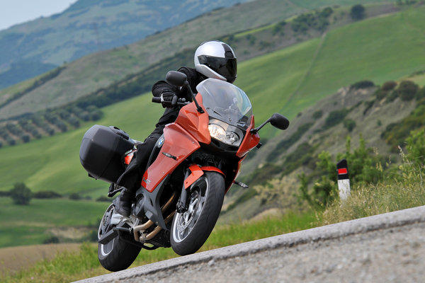 BMW's 2013 F800GT, a mid-sized touring bike that handles well but has some upper-range power issues.