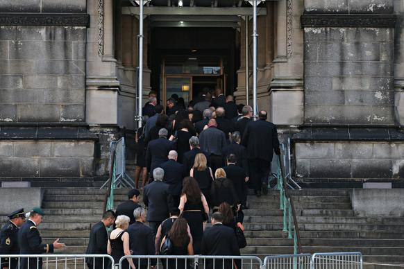 People enter the Cathedral Church of Saint John the Divine for actor James Gandolfini's funeral services.