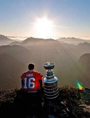 Andrew Ladd was flown to the top of Crown Mountain -- just north of Vancouver -- in a helicopter to watch the sun rise with Stanley. How romantic.