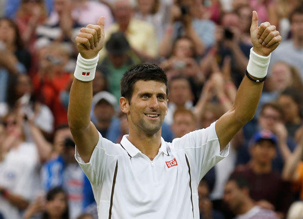 Novak Djokovic of Serbia celebrates after defeating Bobby Reynolds of the U.S. during their men's singles tennis match at the Wimbledon Tennis Championships, in London June 27, 2013.