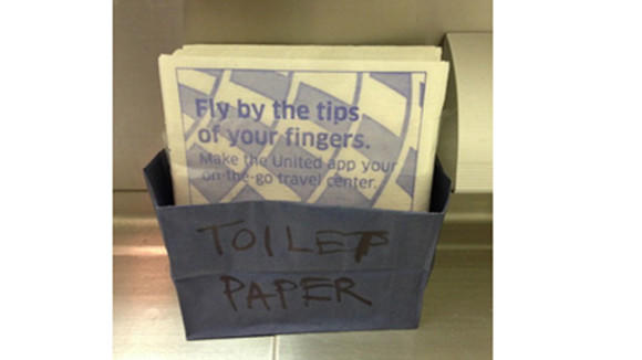 A picture taken by a United Airlines passenger of the makeshift TP on a recent flight to London. The photo was later posted on a popular aviation message board.