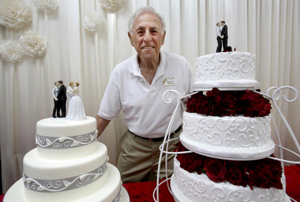Charlie Feder owner of Rossmoor Pastries with wedding cakes celebrating gay marriage.