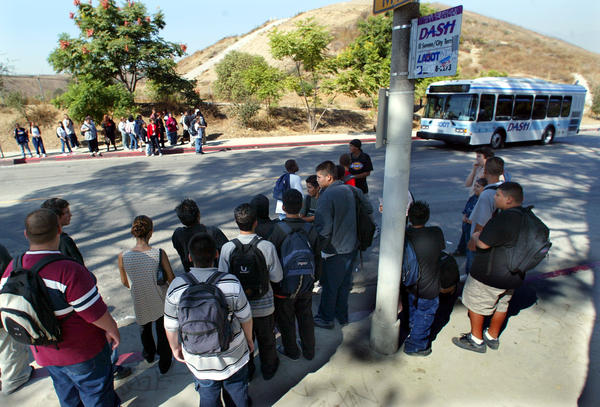 Students wait for a DASH bus on Multnomah Street in this file photo.