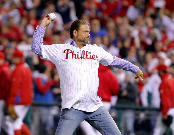Former Philadelphia Phillies catcher Darren Daulton throws out the ceremonial first pitch for Game 6 of the Major League Baseball NLCS playoff series against the San Francisco Giants in Philadelphia, October 23, 2010.