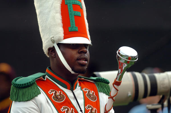 Robert Champion was a drum major in Florida A&M University's Marching 100 band. Twelve people are charged in connection with Champion's hazing death and one other has pleaded no contest.